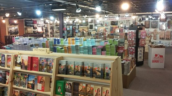 The upstairs section features books and Bibles but is dominated by fiction titles at 7.99